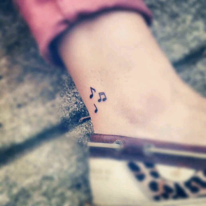 20c55c672 32 Cool Music Note Tattoo Ideas