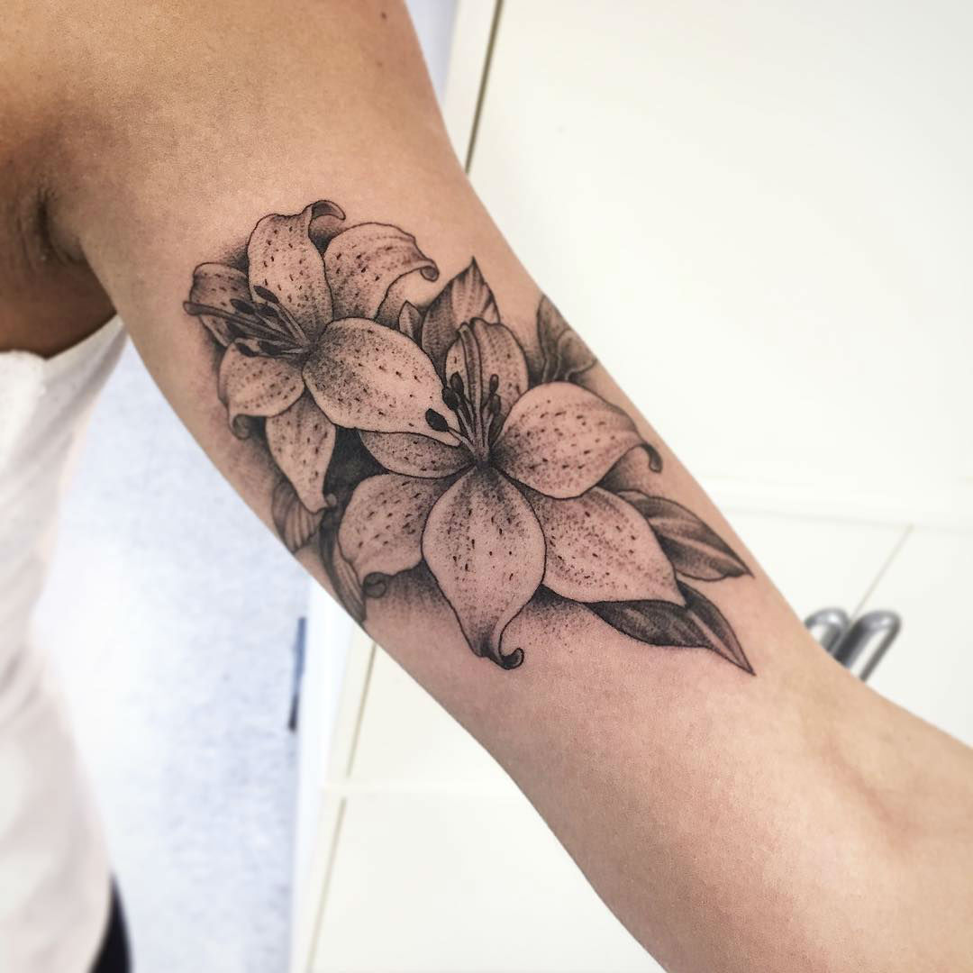 Lily Flower Tattoos On Wrist: 24 Symbolic Lily Tattoo Ideas