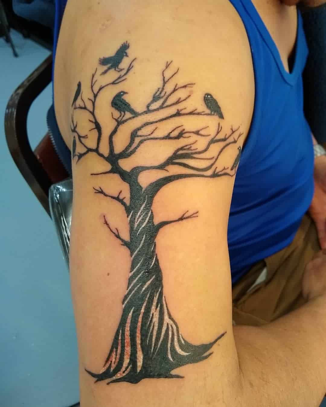 23 Mystique and Seductive Raven Tattoo Designs