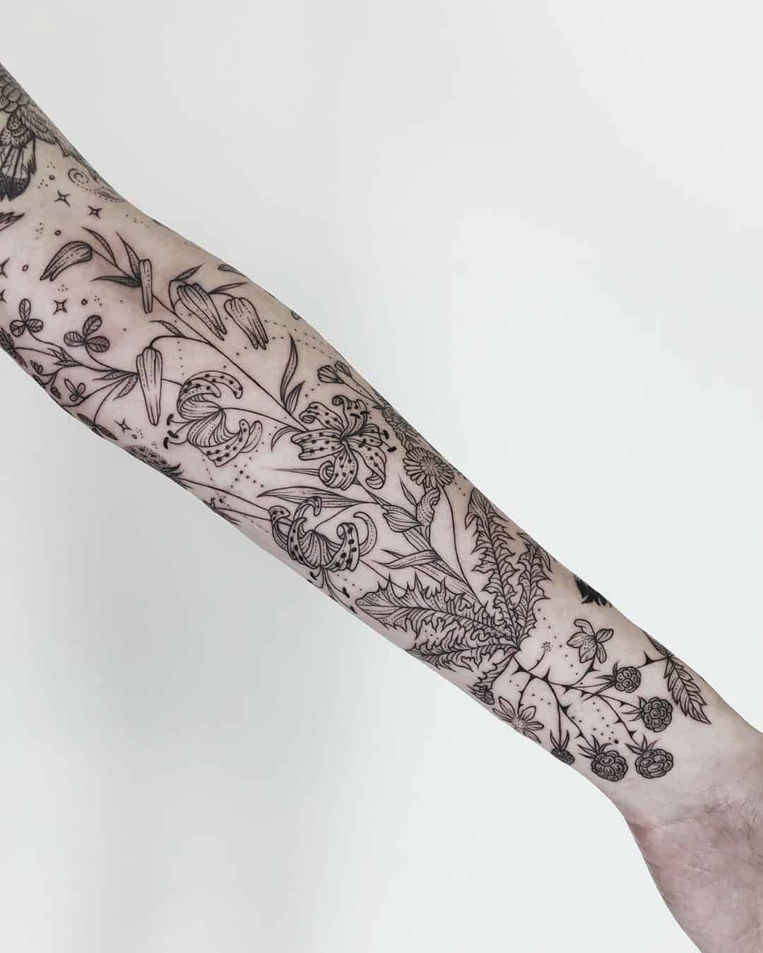 Plants, Alchemy, Space, and Animals in One Tattoo Symphony